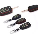 Housse de clé en cuir pour Volkswagen - type de clé V2 vert clair - lumineux, noir/rouge